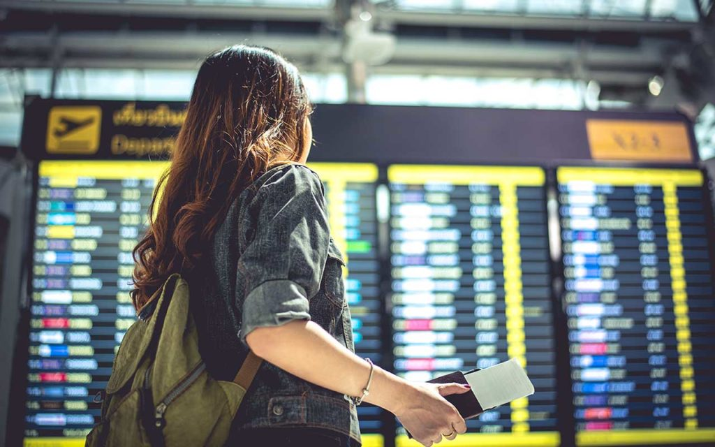 woman looking at flight board