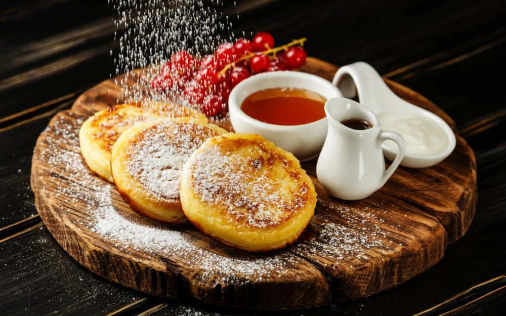 Ukrainian dessert - syrniki or syrnyky on a table