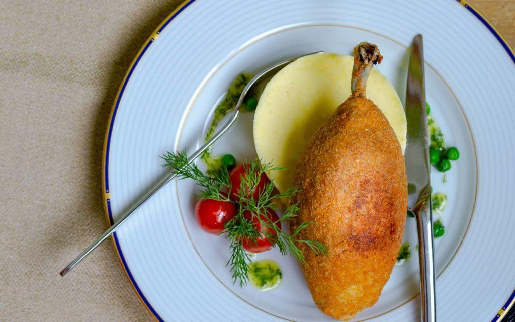 Ukrainian traditional cuisine - chicken kyiv or chicken kiev on a plate