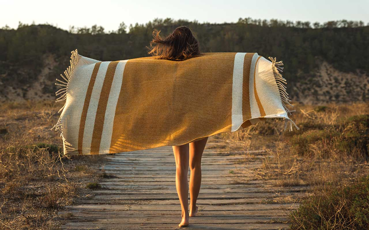 woman holding travel blanket