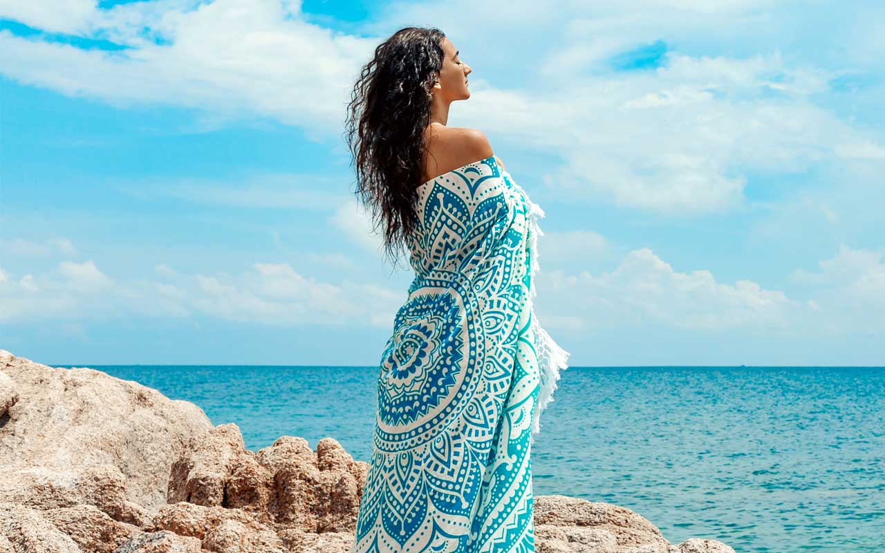 woman wrapped in patterned blanket