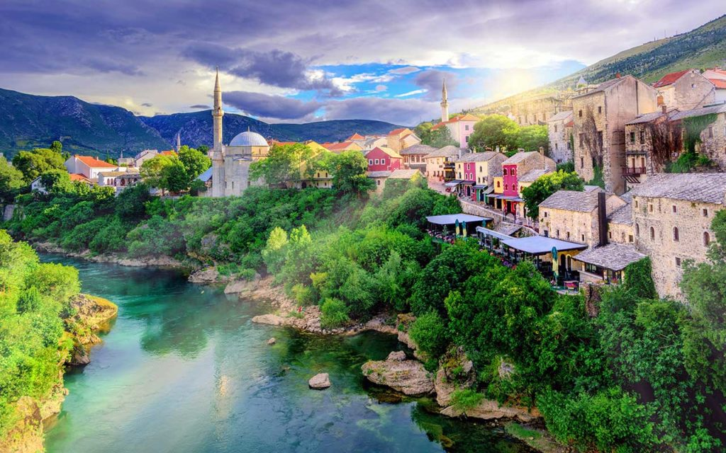 Sunrise over Mostar Old Town and Neretva river