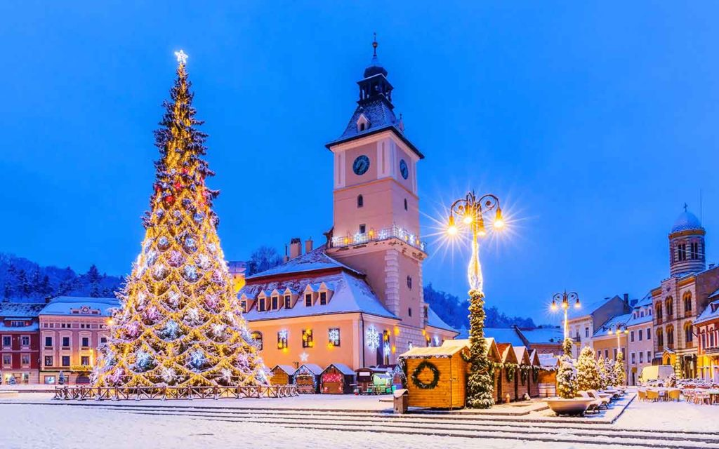 Brasov, Romania. Old Town Christmas Market at twilight.