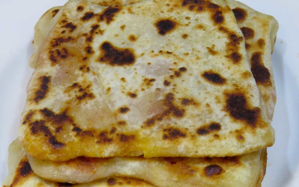 Algerian Food: Mhajeb – Flatbread with Tomato and Onion Stuffing
