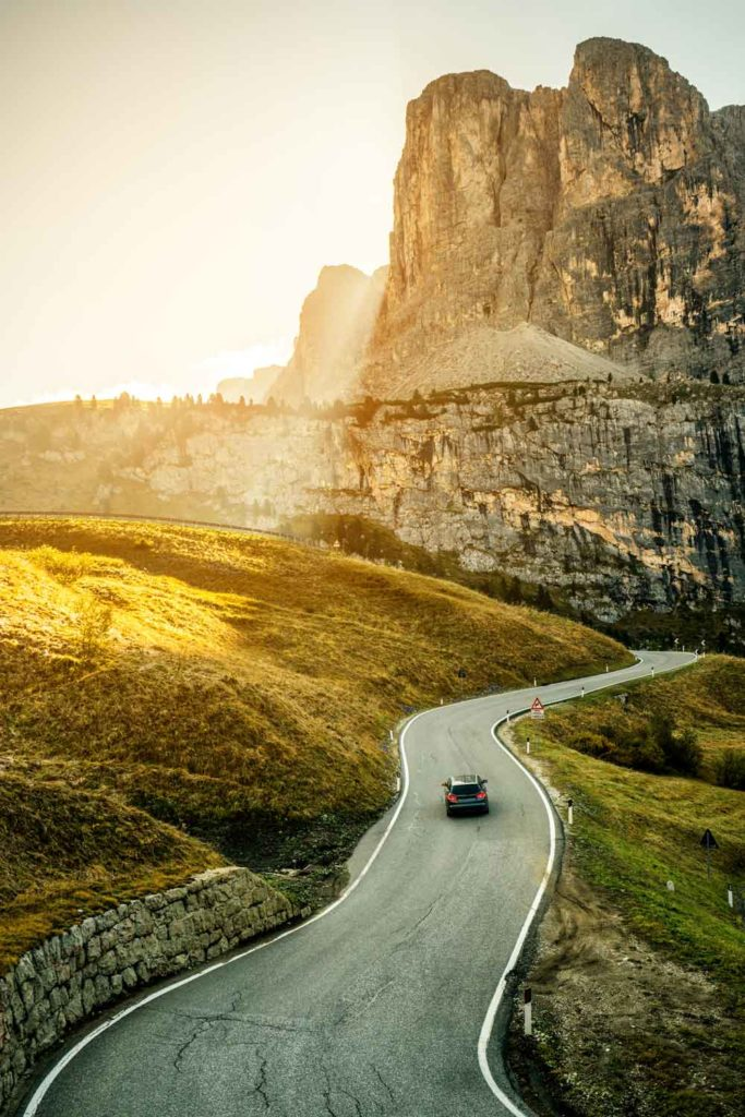 Staycation idea: road trip, a car on a winding road