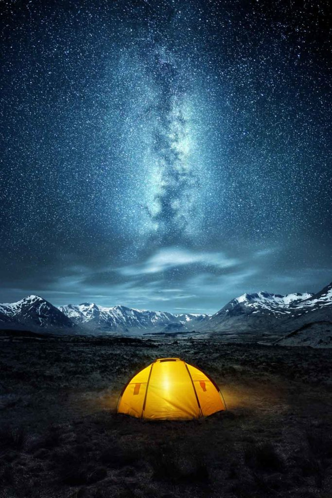 Staycation idea: stargazing from a tent at night with beautiful stars in the sky