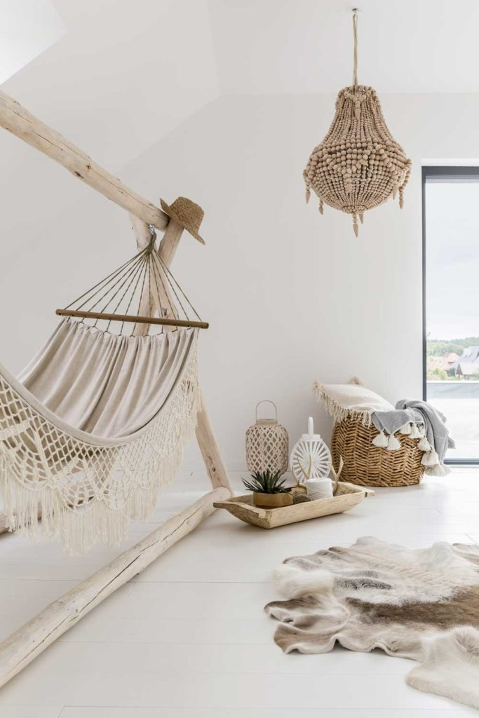 Staycation idea: Beige home oasis with a hammock and other relaxing touches