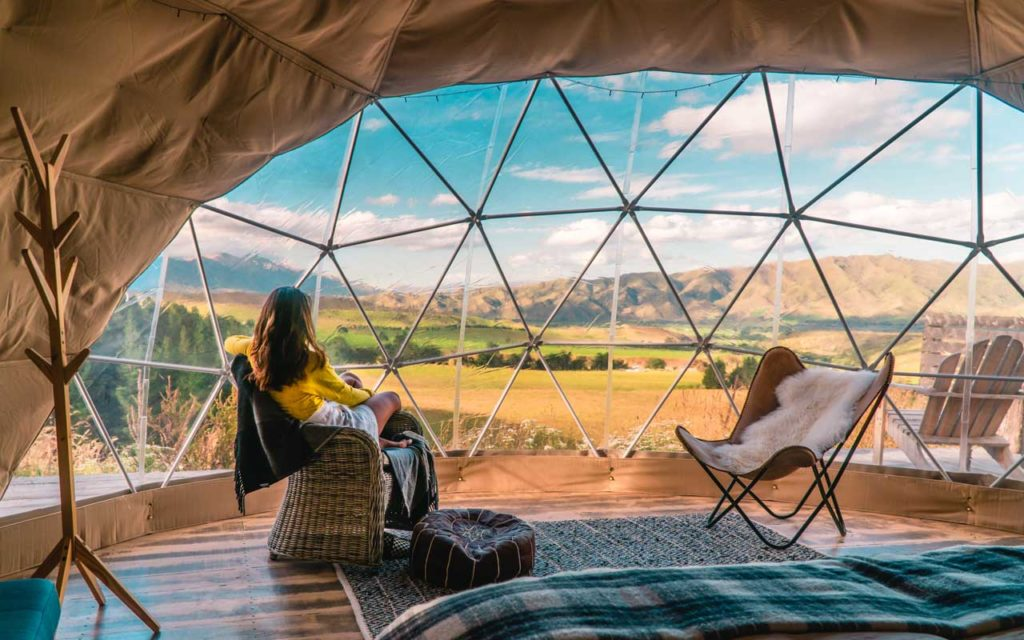 Looking out at the beautiful scenery from a glamping tent