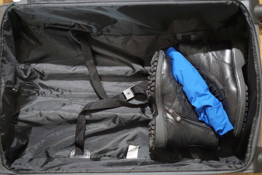 packing boots in a suitcase