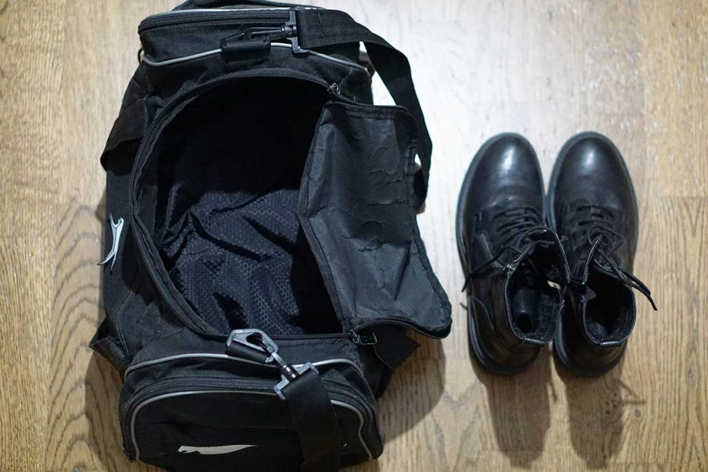 packing shoes in a duffel bag