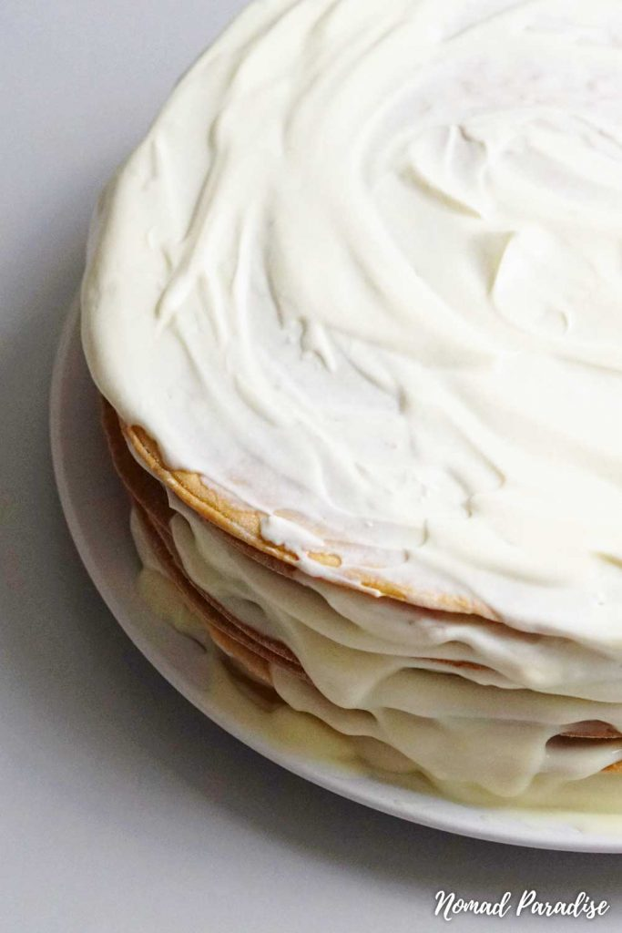 Assembled Russian Honey Cake (Medovik) layers with frosting on top