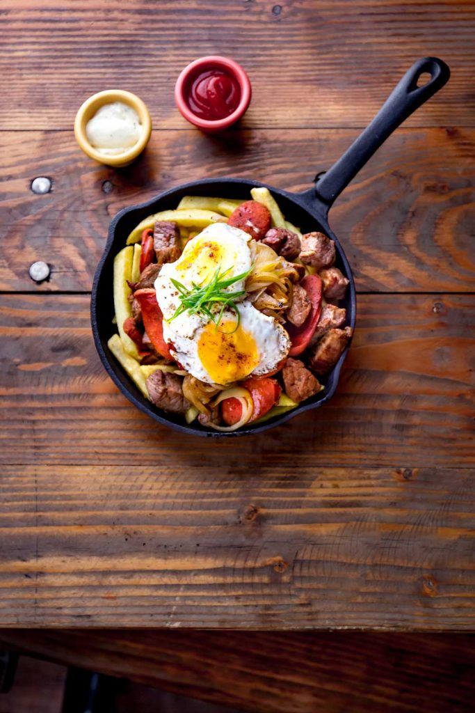 Chilean food: Chorillana (French Fries Topped with Meat, Onions, and Fried Eggs)