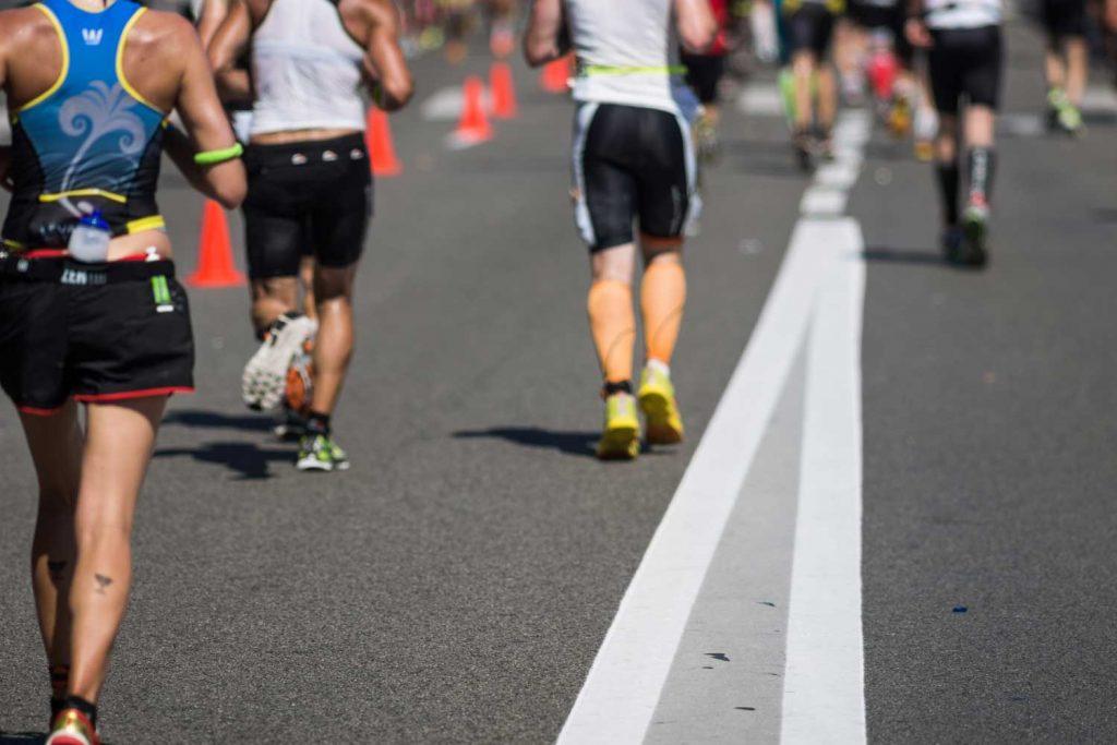 Extreme Sport: People Running in a Marathon / Triathlon