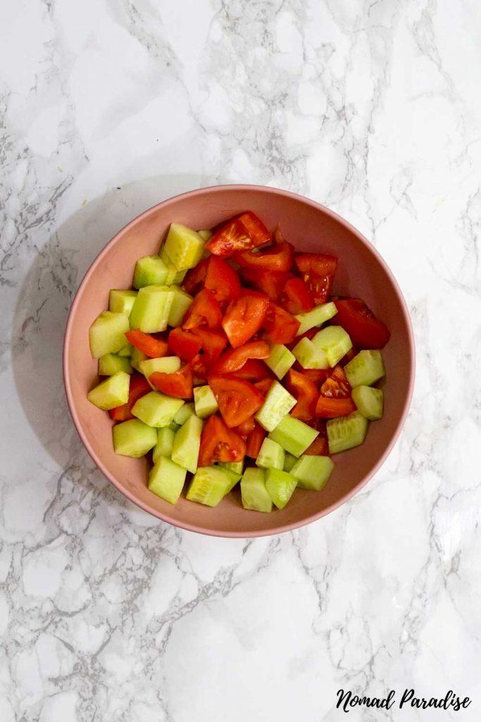 Shopska salad: chopped tomatoes and cucumbers